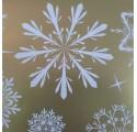 Papel de regalo oro liso con diseños de nieve